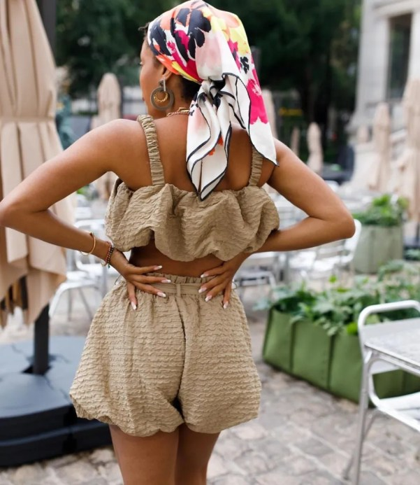Ellie from Slip Into Style wears headscarf and statement accessories
