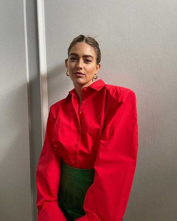 emili sindlev wearing a red colour block shirt
