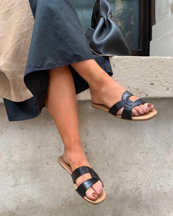Olivia Levett wearing black flat New Look sandals
