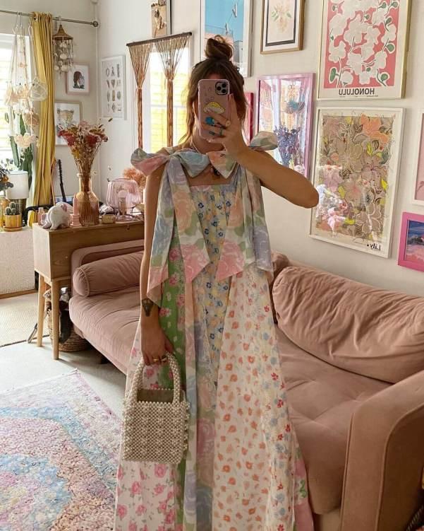 sara waiste wearing floral dress and shrimps bag
