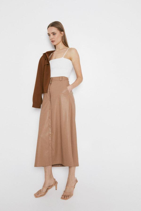 Faux leather popper front midi skirt, now £44, Warehouse