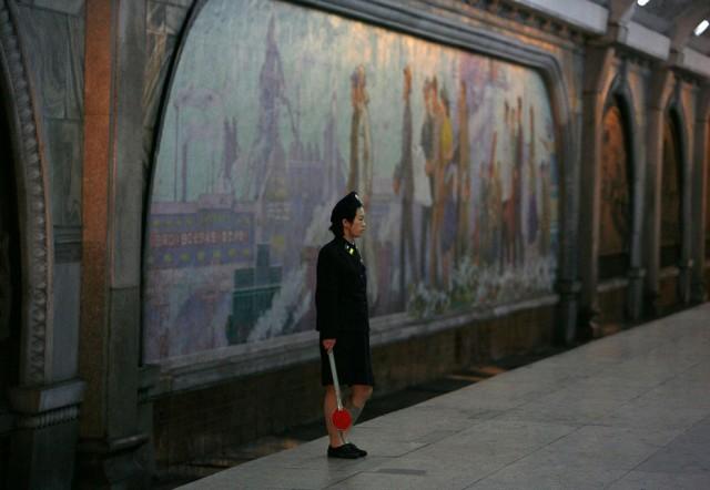Women Working in North Korea - Train Guard