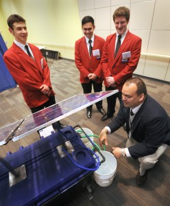 Office of Technology Investments MEP Center Director James Ruble, right, talks with Polaris Career Center students from Cleveland about their solar powered portable water filtration system during the 2014 SkillsUSA Ohio Championships competition in Columbus.