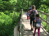 A family goes on a hike at Conkle's Hollow.