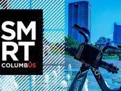 SMRT Columbus logo overlaid on top of the city skyline with a bike int he forground