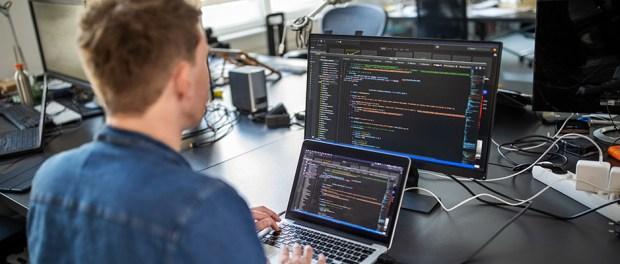 Computer programmer working on new software program
