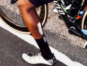 close up on bicyclists leg showing reflective safetyskin product