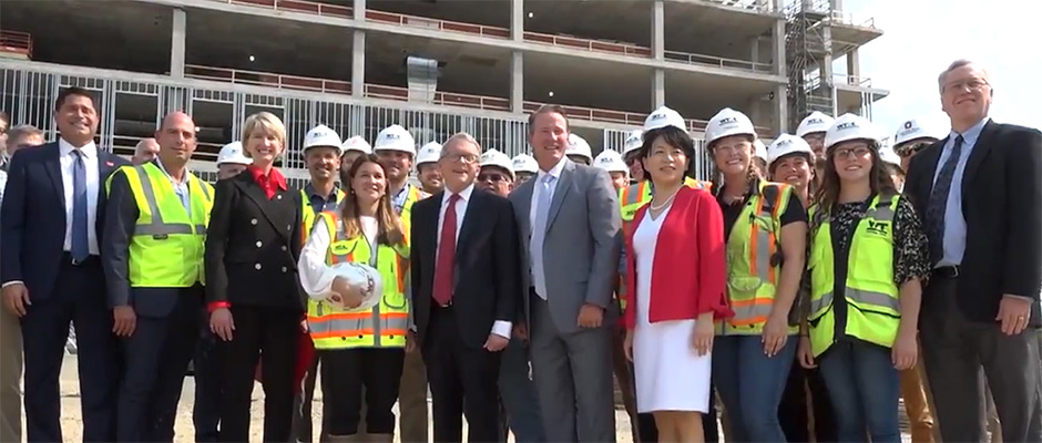 Gov. Mike DeWine and other state officials joined Ohio State University President Kristina Johnson and others to celebrate the beam-topping ceremony for the new Interdisciplinary Research Facility