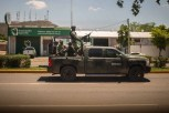 The Mexican Army patrolling the streets of Los Mochis, Sinaloa. Known as Mexico's breadbasket, Sinaloa contains some of the most productive agricultural land in the country, yet the Sinaloa Cartel is using nearby foothills to grow poppies to meet the growing heroin demand in the United States.