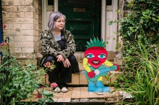 Artist Anna Bean at home with one of her quirky strawberry characters. Photograph taken by James Mulkeen for darts in Doncaster