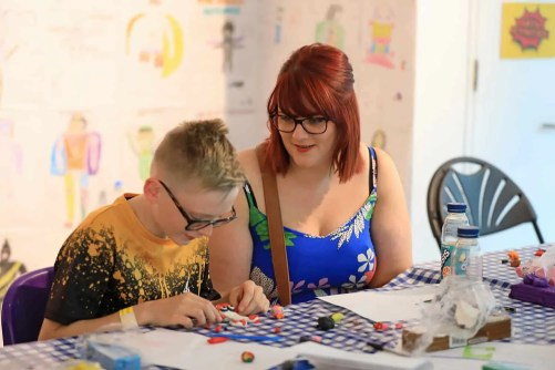 A woman and child doing arts and crafts.