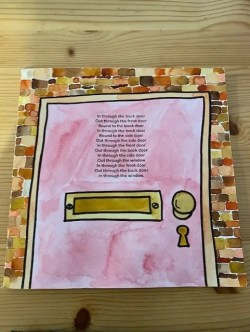 A drawing of a pink door with a golden handle, frame and letterbox.