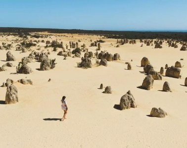 The Pinnacles // Sculptures in the Desert (WA) Eliska Kyrsova, photo Jono Tan, desert, sand, woman, space, rock formations, snadstone