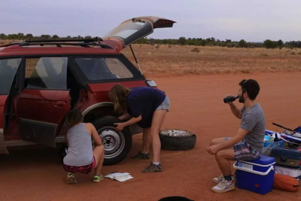 Outback and Back, Ross Clayton, NSW, Desert, changing tyre