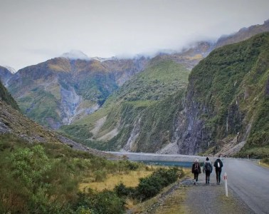 A Stroll Around Fox Glacier Valley // (NZ) Alex Costas, mountains, mist, three hikers, road