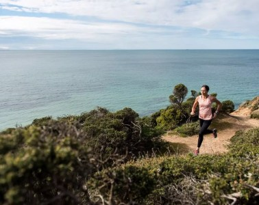 The Ultimate Beginner's Guide To Trail Running, Chris Ord, Pt Addis_Kellie Emmerson, female runner, ocean, coastal track