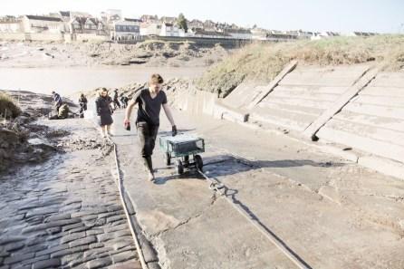 Ferrying the mud up the slipway