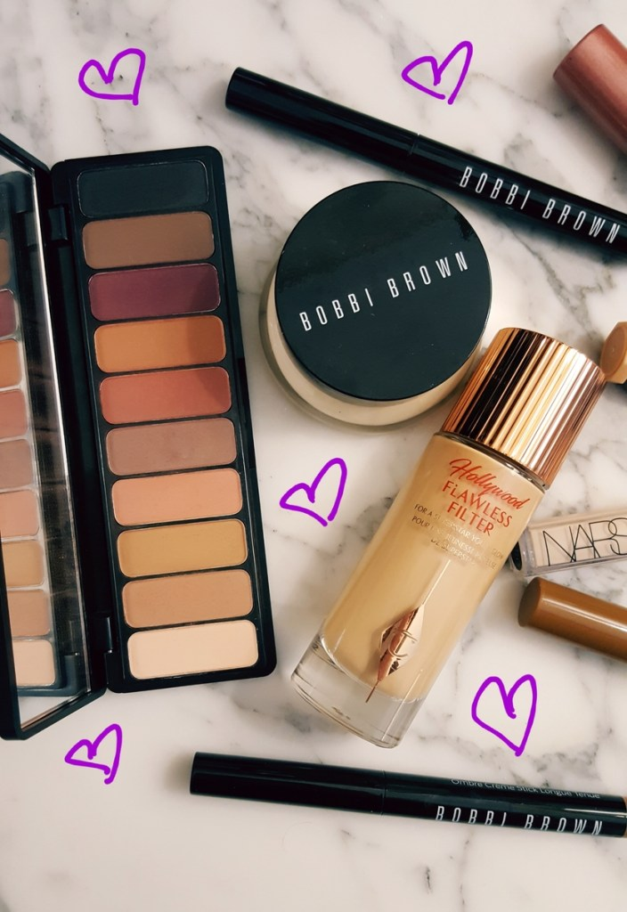 Flatlay with Elf Mad for Mattes Palette in Summer Breeze, Bobbi Brown Tinted Moisturizing Balm, Bobbi Brown Longwear Cream Shadow Stick, & Charlotte Tilbury Hollywood Flawless Filter