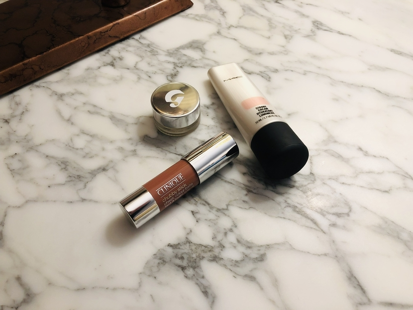 Flatlay of Clinique Chubby Stick Cheek Balm in Amp'd Up Apple, Glossier Stretch Concealer & MAC Strobe Cream