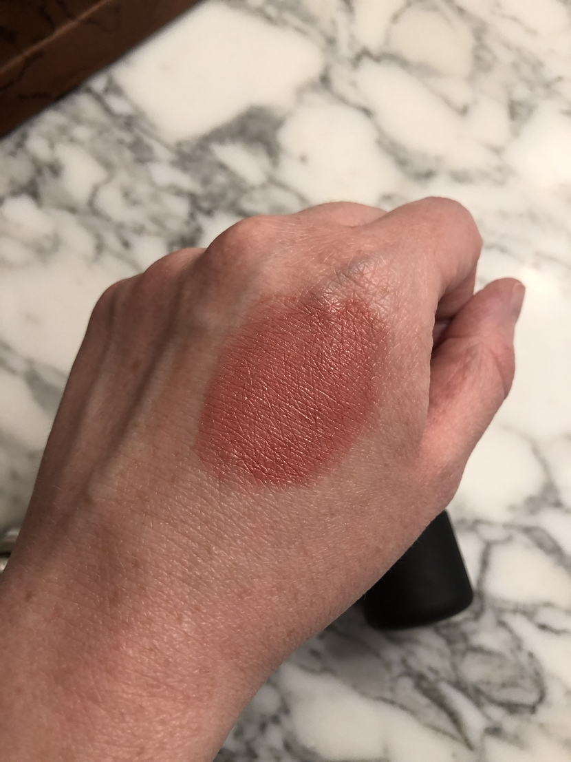 Swatch on hand of the Clinique Chubby Stick Cheek Balm in Amp'd Up Apple