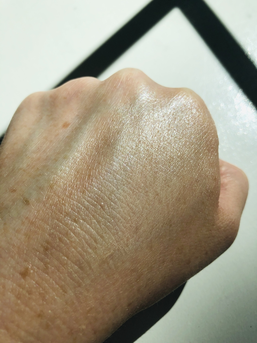 L'Oreal Lumi Glotion & Weleda Skin Food Light mixed together on back of my hand