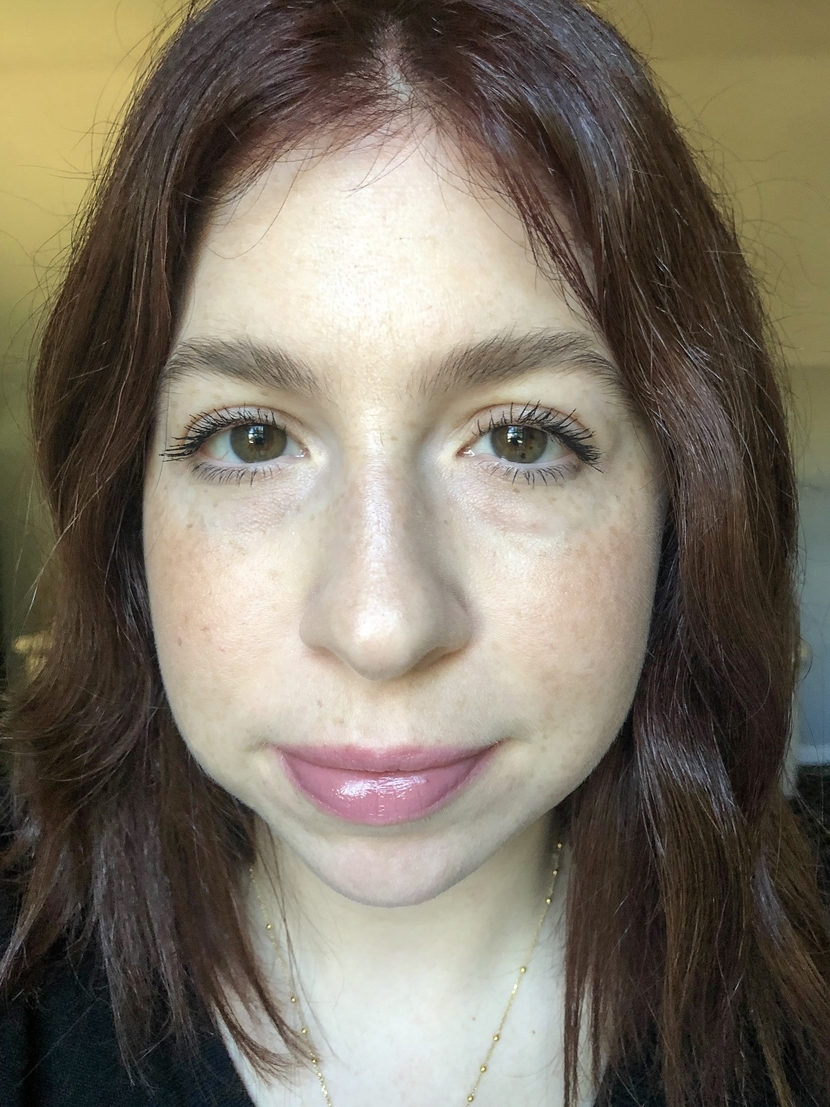 Selfie displaying two mascara application methods using Maybelline Snapscara. Left eye - brush wiggle, right eye - blinking.