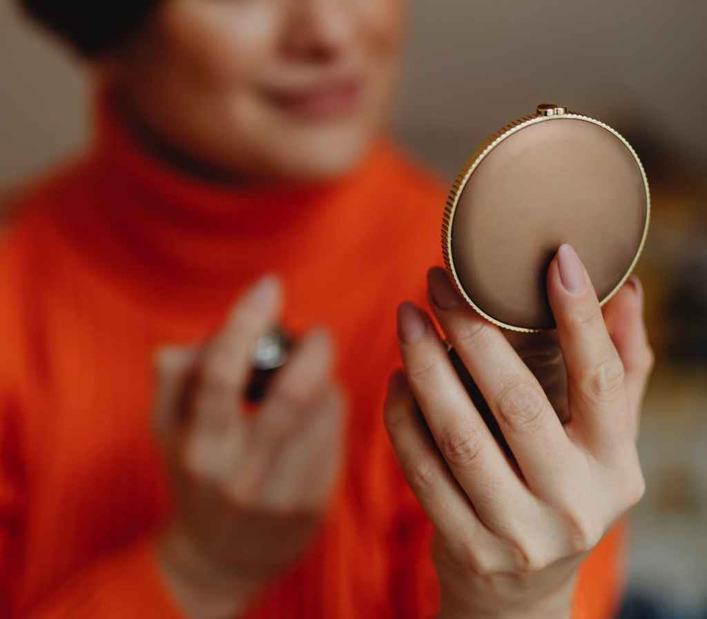 Woman holding brown compact
