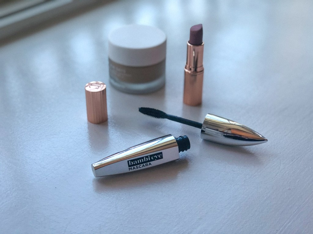 Portrait of L'Oreal Bambi Eye Mascara with other beauty products