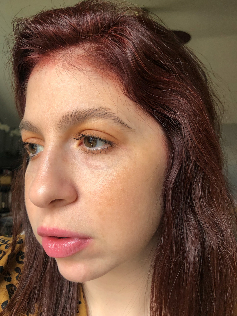 Makeup look with cream bronzer blended across cheeks