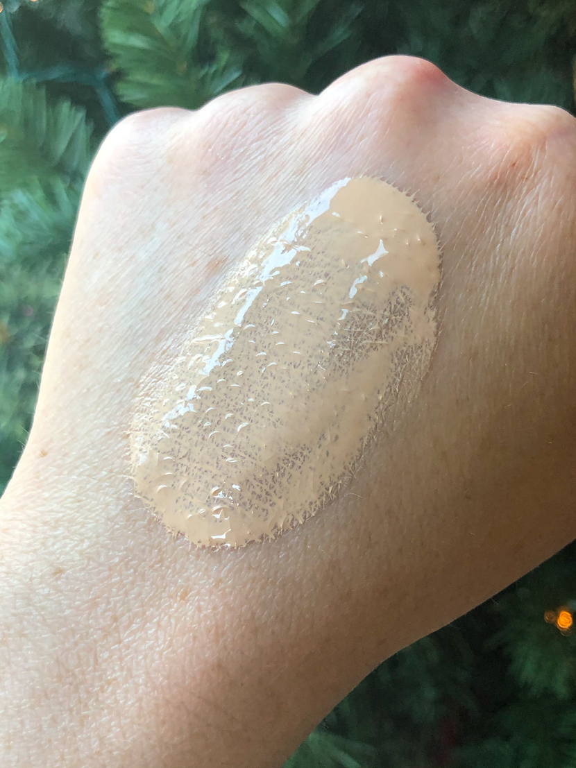 Swatch of Flower Beauty Get Real Serum Foundation rubbed into the back of my hand in the shade Porcelain