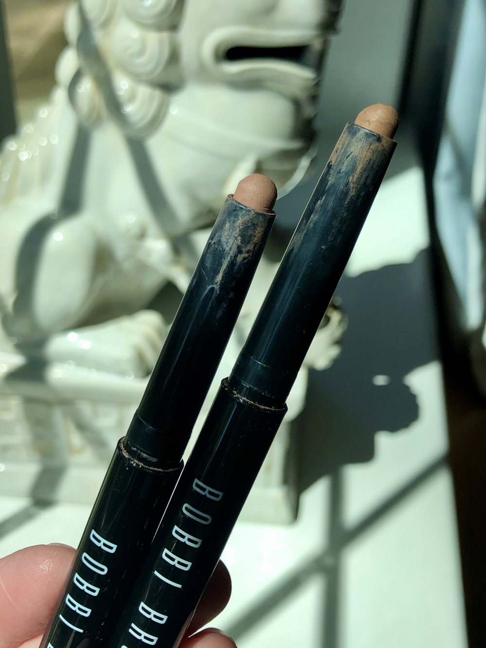 Bobbi Brown Long-Wear Cream Shadow Sticks in Nude Beach and Taupe, which are a few of my go-to everyday eyeshadows