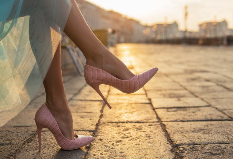 Woman in high heel shoes in city by sunrise Image ID:289040633