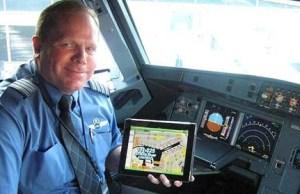 pilote utilisant un iPad en vol