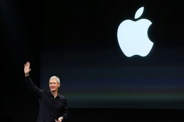 Apple CEO Tim Cook speaks during a presentation at Apple headquarters in Cupertino in this file photo