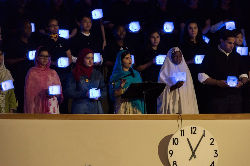 Restless Development South Africa's Athini Nyatela standing with Nobel prize winner Malala Yousafzai at the opening ceremony of the United Nations Sustainable Development Summit