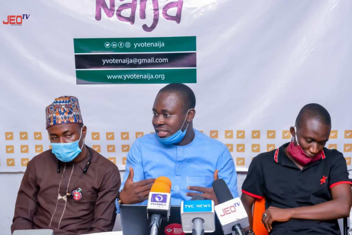 """Three members of the """"y vote naija"""" team at a discussion about making voting accessible to young Nigerians"""