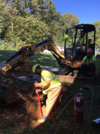 Digging to place the gas line connector.