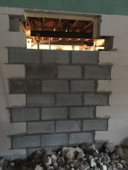 Bricking in one of the kitchen doors.