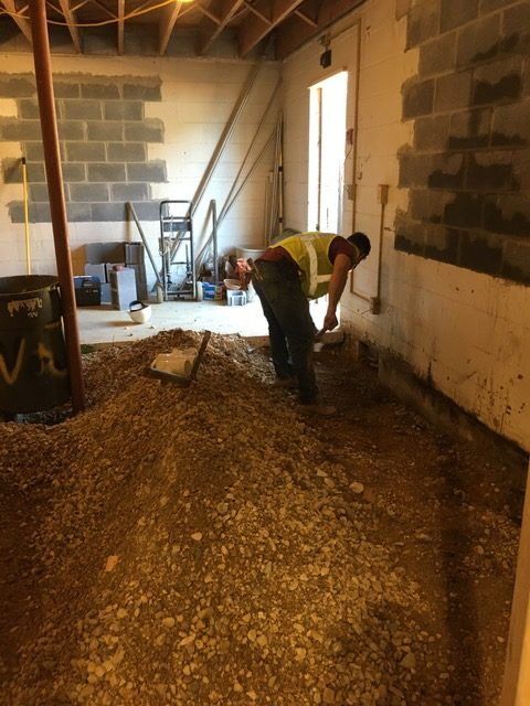Digging for pipe placement in area where dishwashing will take place.