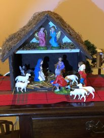 This is special because the figures were the ones I grew up with and the manger was built and painted by a dear friend.(His name is Paul, too.🙂) The wise men and a camel are across the room, and the baby Jesus is in the drawer below the manger. Debbie R.
