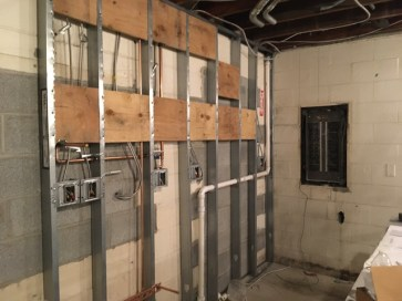 Roughed-in plumbing and electric behind the coffee prep area.