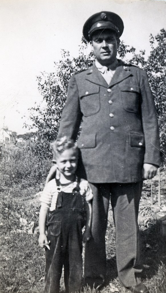 black and white photo of Richard smock in a somber military uniform next to his smiling young son ray smock.