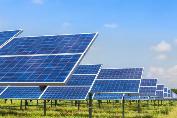 Commercial Scale Solar Array. Photo Credit: Soonthorn Wongsaita/shutterstock.com