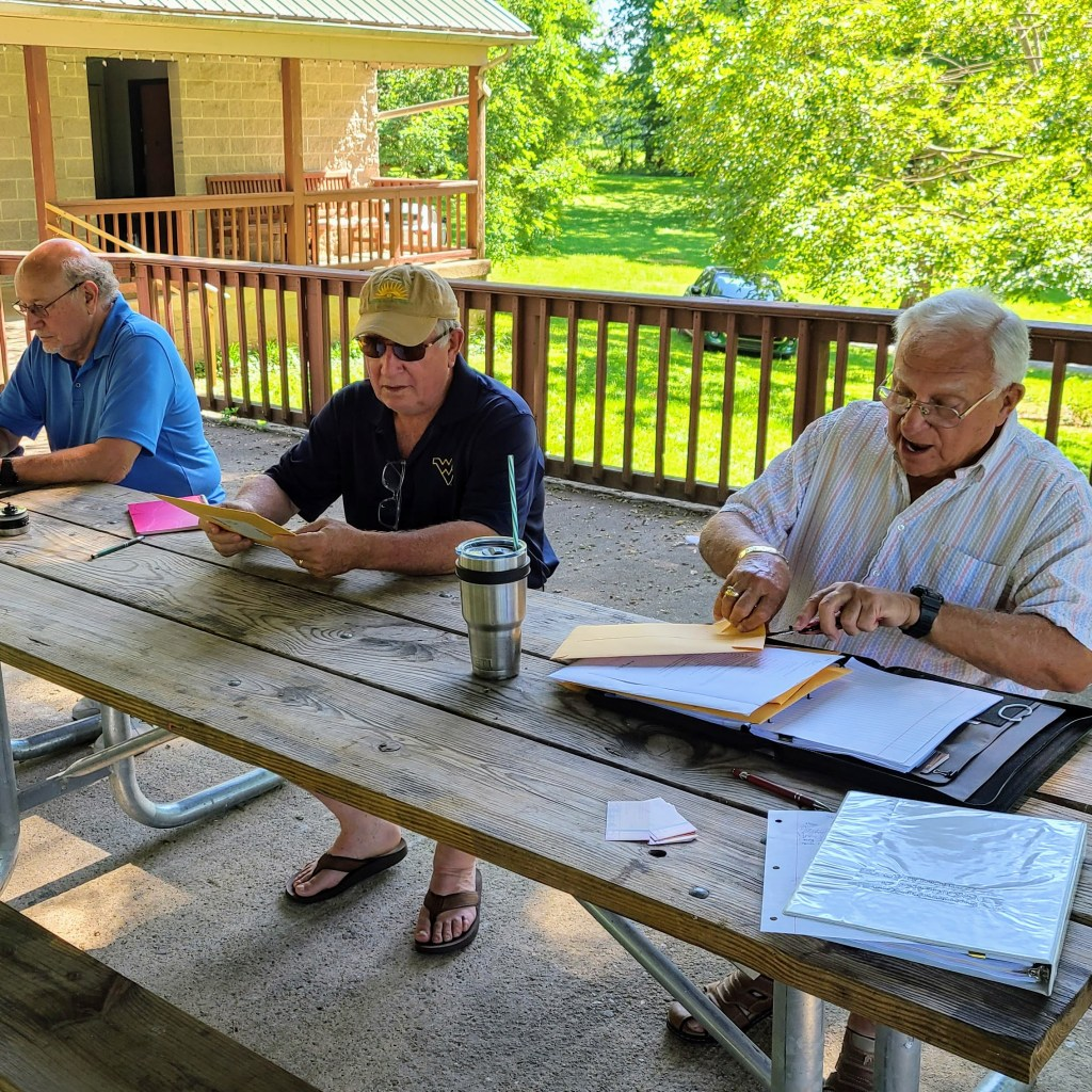 The library board gathered on June 30 to open construction bids for the new building.