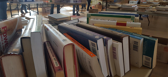 books on a table at a book sale.