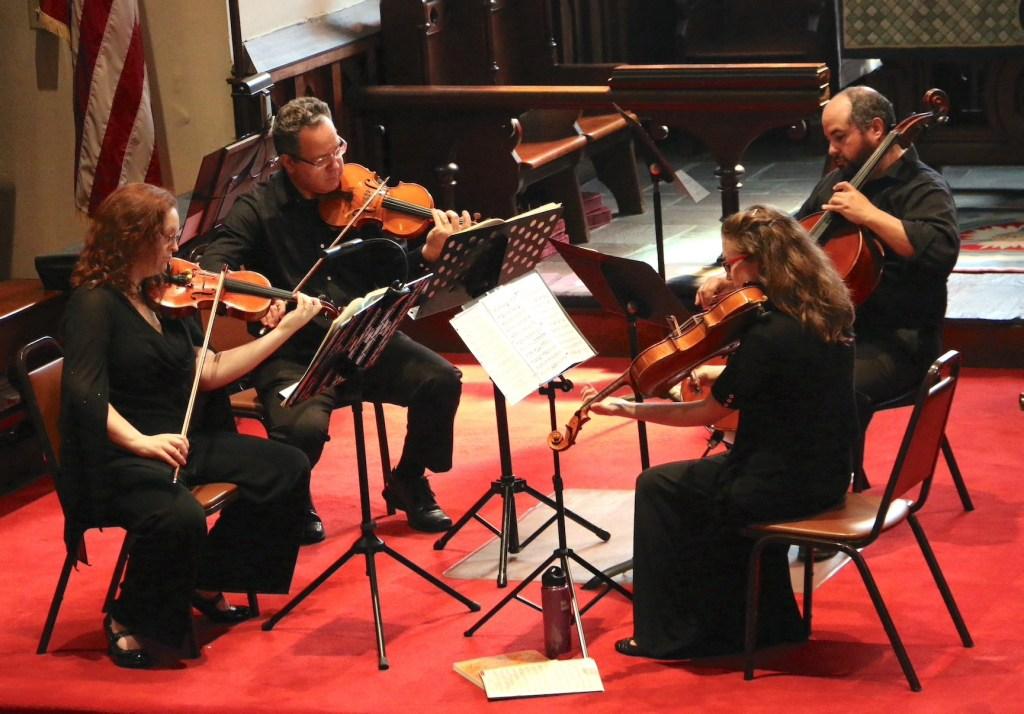 Two Rivers String Quartet performing.