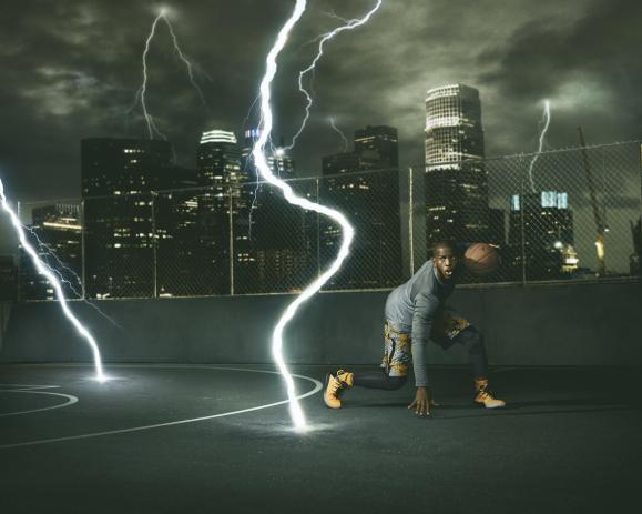 Chris Paul wearing the Jordan CP3.IX yellow dragon