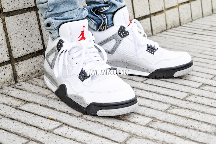 81cdf744668e83 Air Jordan 4 Retro  White Cement  on feet 2 - WearTesters