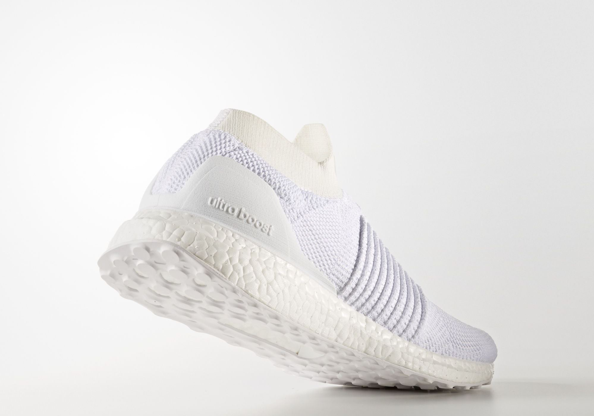 5e70f7738d00a adidas Ultra Boost Laceless Mid Triple White - Back heel - WearTesters