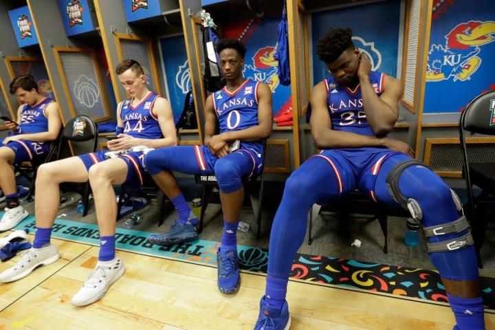 college basketball scandal adidas kansas jayhawks